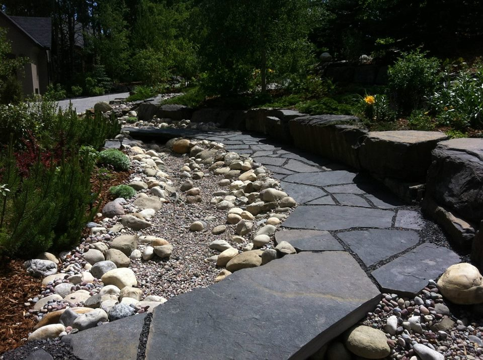 CityScape Landscaping Calgary - Dry river bed with stone bridge / pathway rundle
